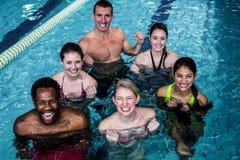 Fitness group doing aqua aerobics Stock Photos