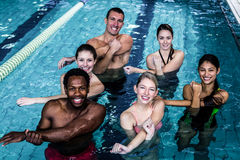 Fitness group doing aqua aerobics. In the pool Royalty Free Stock Photography