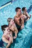 Fitness group doing aqua aerobics. In swimming pool Royalty Free Stock Photography