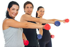 Fitness group lifting barbell Stock Photos