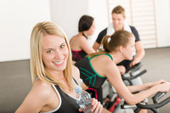 Fitness group of people on gym bike Royalty Free Stock Photo