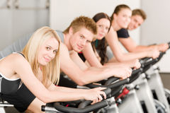 Fitness group of people on gym bike Stock Images