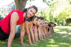 Fitness group planking in park Royalty Free Stock Image