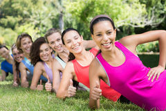Fitness group planking in park Stock Images