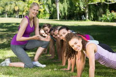 Fitness group planking in park Stock Photography