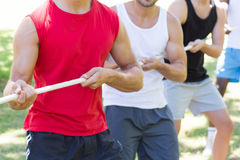 Fitness group playing tug of war Royalty Free Stock Photo