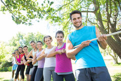 Fitness group playing tug of war Royalty Free Stock Photography
