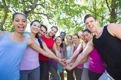 Fitness group putting hands together Royalty Free Stock Images