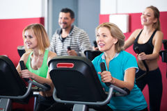 Fitness group riding stationary bicycles Stock Images
