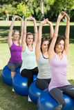 Fitness group sitting on exercise balls Royalty Free Stock Photos