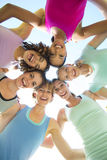 Fitness group standing in circle Royalty Free Stock Images