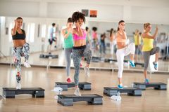 Fitness group training on stepper Stock Images