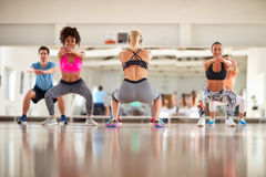 Fitness group warm up with female instructor. Fitness group warming up in gym with female instructor stock image