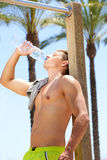 Fitness guy drinking water after workout Royalty Free Stock Image