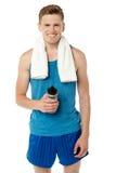 Fitness guy holding sipper bottle Stock Photo