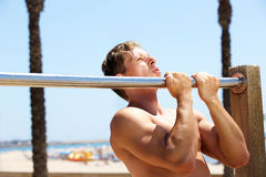 Fitness guy pull up workout routine Stock Photos