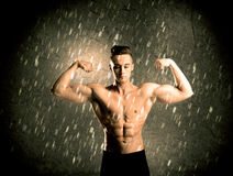 Fitness guy with weight showing muscles Royalty Free Stock Photo
