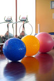 Fitness gym. Equipment and fitness balls Stock Photos