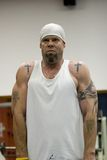 Fitness gym. Fitness training, cool tattooed man exercising in the gym Royalty Free Stock Image