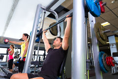 Fitness gym man multipower system weightlifting Stock Photos