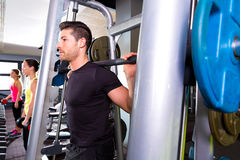 Fitness gym man multipower system weightlifting Stock Image