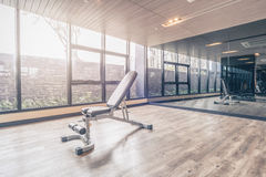 Fitness gym with the modern sport equipment. Stock Photography