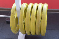 Fitness gym sport equipment. Hanged heavy lift weights Royalty Free Stock Images