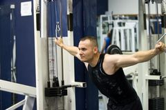 Fitness gym training. The photo is taken indoors under florescent light with no flash Royalty Free Stock Image