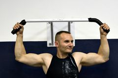 Fitness gym training. Caucasian guy training at the gym,bar exercise Stock Photography