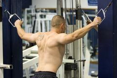 Fitness gym training. Caucasian man training in the gym Stock Images