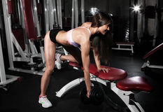 Fitness gym woman strength training lifting dumbbell weights Stock Photography
