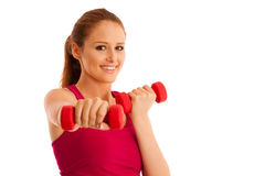 Fitness gym - woman works out with dumbbells isolated over white Stock Image