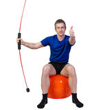 Fitness with gymball and flexibar Royalty Free Stock Photos