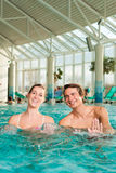 Fitness - gymnastics under water in swimming pool stock photos