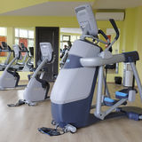 Fitness hall with sport equipment. Interior of a fitness hall with sport equipment Royalty Free Stock Photo