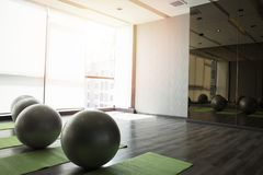 Fitness hall with sport equipment interior of gym with yoga royalty free stock photography