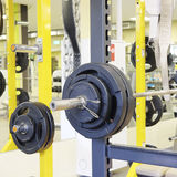Fitness hall with weights and other sport equipment. Interior of a fitness hall with weights and other sport equipment Royalty Free Stock Image