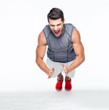 Fitness handsome man doing push ups Stock Photos