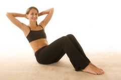 Fitness and Health. Beautiful young woman wearing workout clothes Royalty Free Stock Image