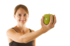 Fitness and Health. Beautiful young woman holding an apple - focus is on apple Stock Photo