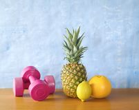 Fitness and health. Dumbells and fruits, fitness and health, free copy space Royalty Free Stock Photography
