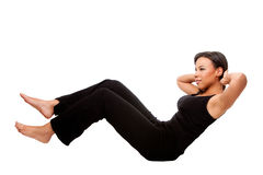 Fitness health exercise. Young happy beautiful woman during fitness time exercising for health  staying in shape doing crunches situps, in black, isolated Stock Photo