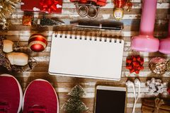 Fitness and Healthy Christmas sport composition. Overhead shot of sport shoes, dumbbells, skipping rope and Christmas ornaments stock images