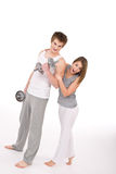 Fitness - healthy couple exercising with weights Stock Images