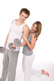 Fitness - healthy couple exercising with weights Stock Photography