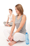 Fitness - Healthy couple stretching on white Royalty Free Stock Photo