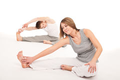Fitness - Healthy couple stretching on white Royalty Free Stock Image