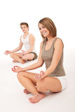 Fitness - Healthy couple stretching in yoga Royalty Free Stock Image