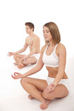 Fitness - Healthy couple in yoga position Royalty Free Stock Photos