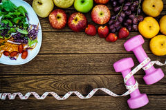 Fitness, healthy fruits fresh healthy salad, diet and active li Royalty Free Stock Images